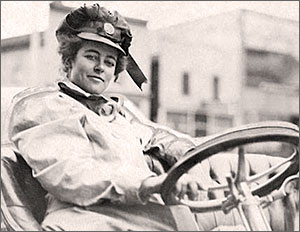 Cross country women race car driver Alice Ramsey behind the wheel of her early 1900s car.