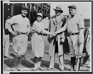 Early female baseball teams player Jackie Mitchell shakes hands with Babe Ruth in 1931.
